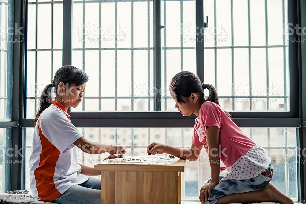 Children playing chess stock photo