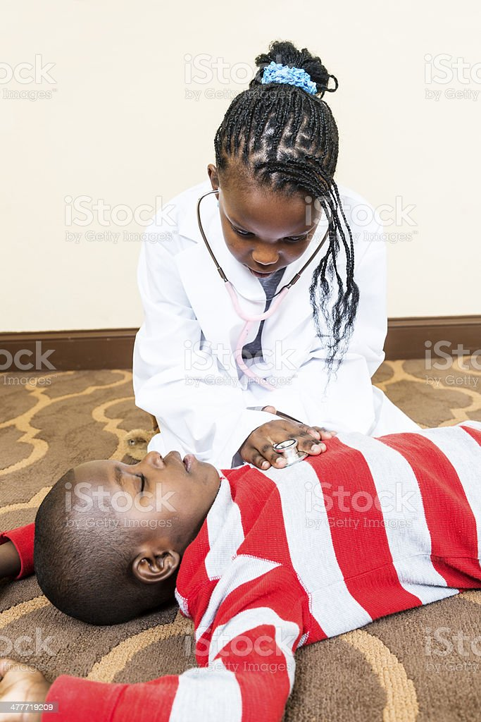 Children Playing Doctor royalty-free stock photo