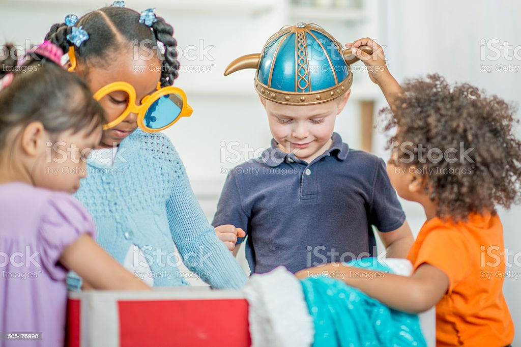 Children Playing Dress Up Together at School stock photo