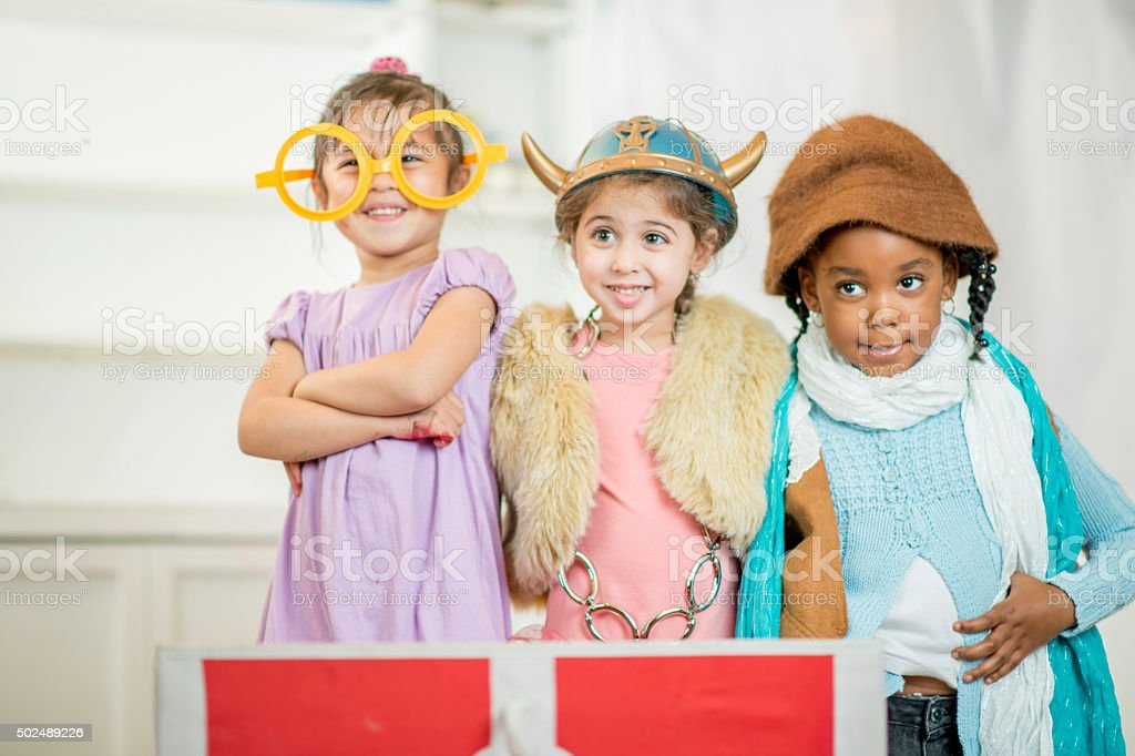 Children Playing Dress Up Together stock photo
