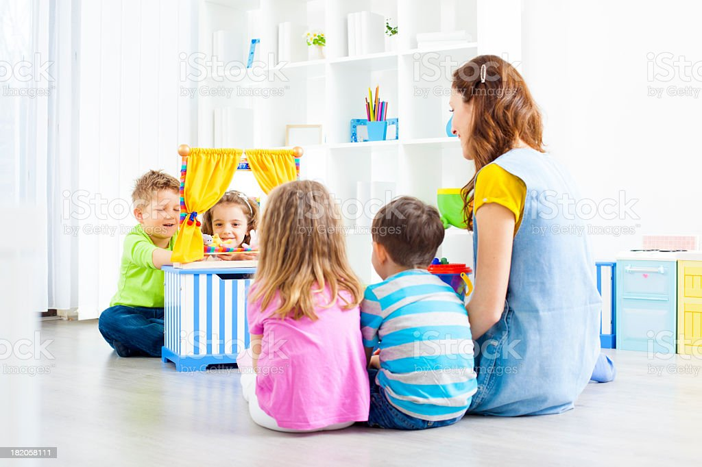 Children Playing Finger Puppet Show. royalty-free stock photo