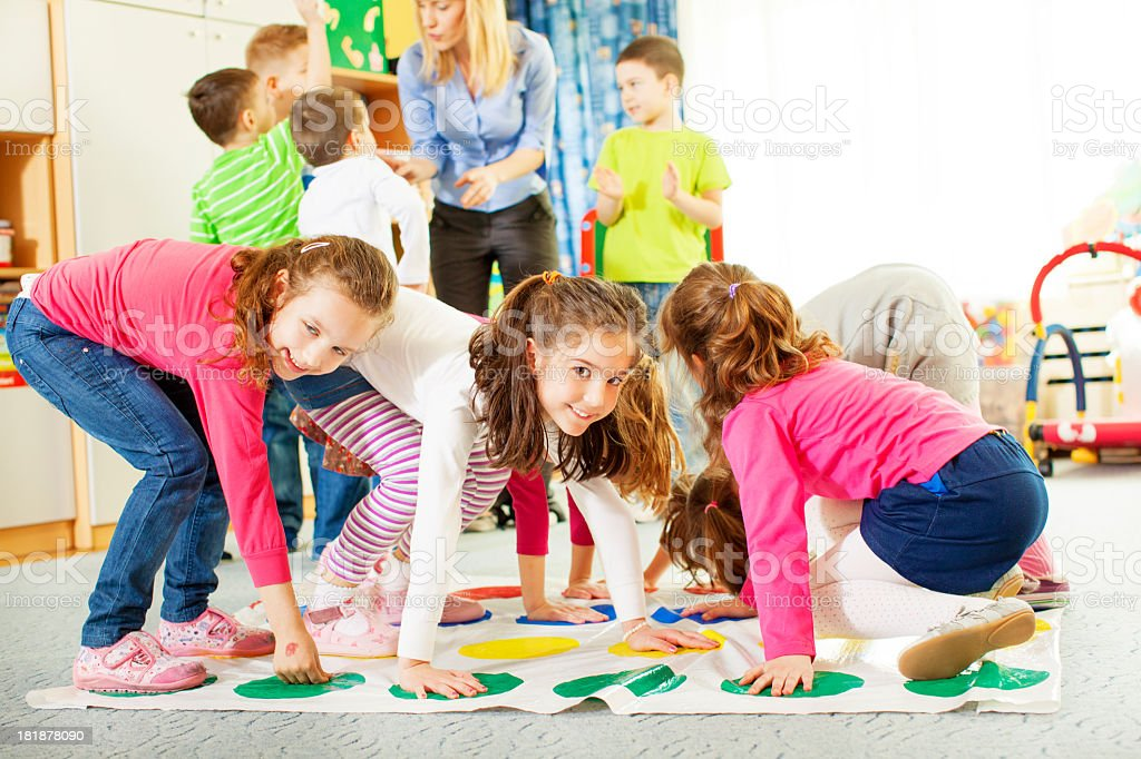 Children Playing Floor Game. royalty-free stock photo