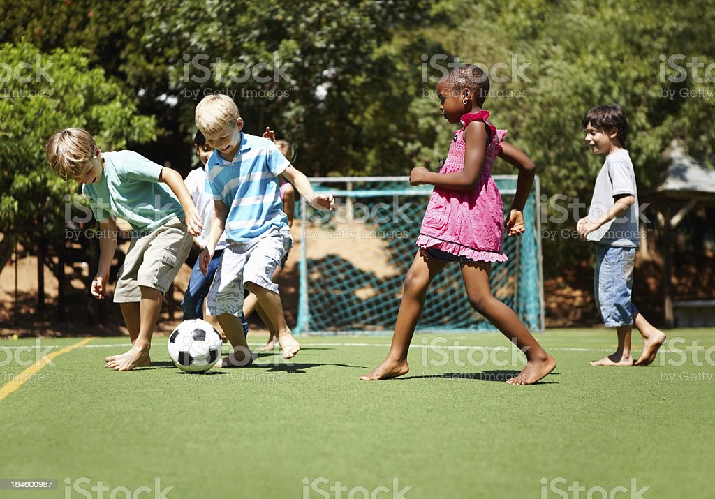Children playing football royalty-free stock photo