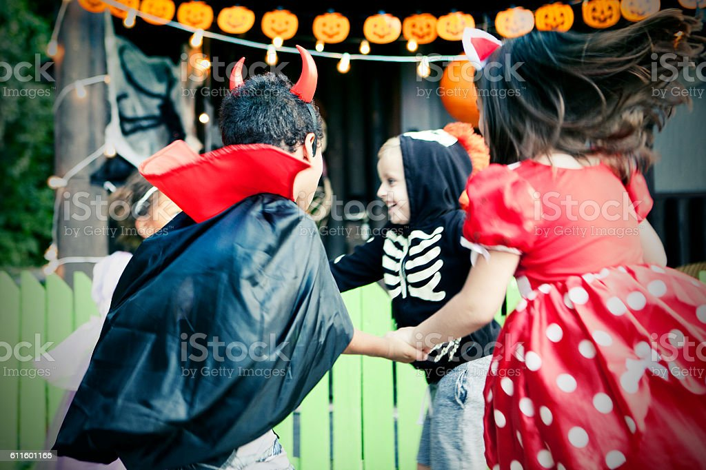 Children playing for Halloween stock photo