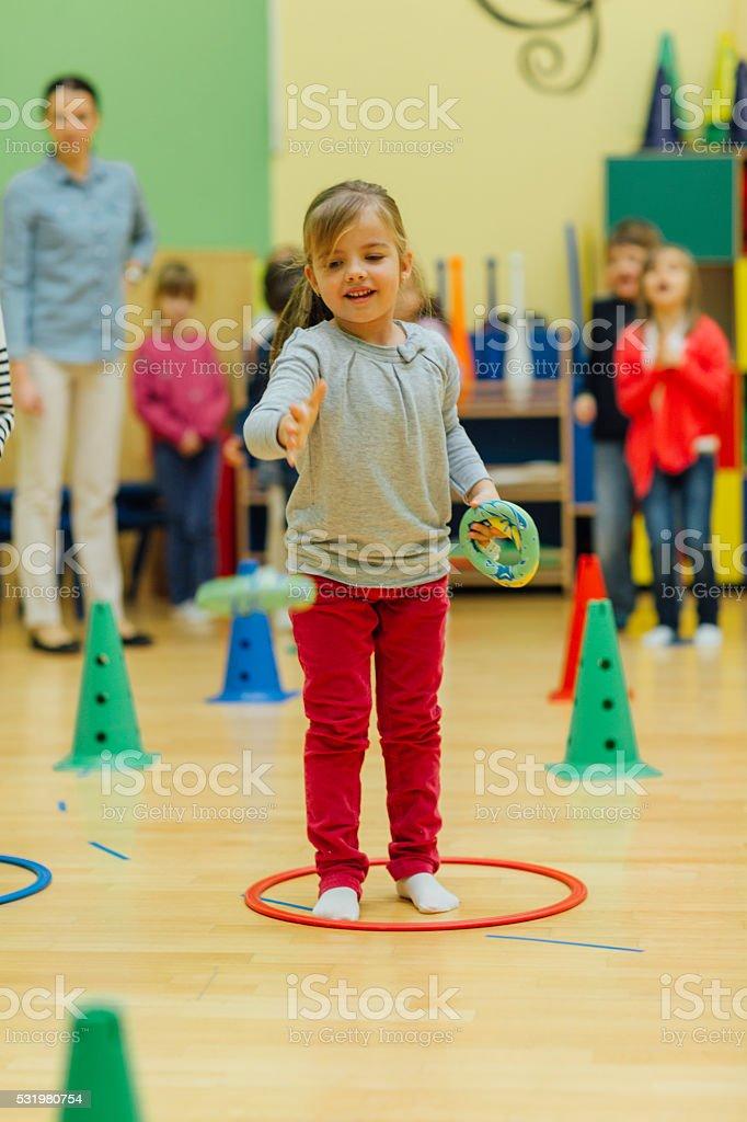 Children Playing Games In Their Kindergarten. stock photo