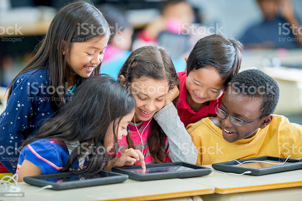 Children Playing Games on a Tablet stock photo