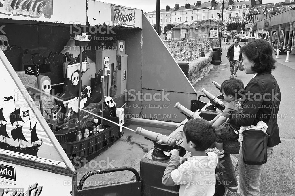 Children playing games on seaside pier royalty-free stock photo