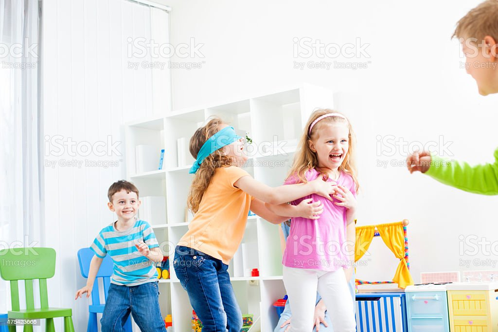 Children Playing Hide and Seek. stock photo