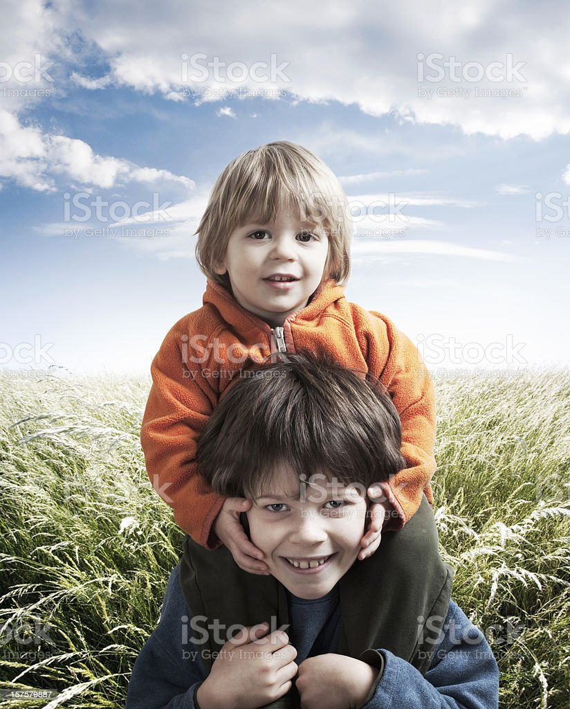 Children playing in a field royalty-free stock photo