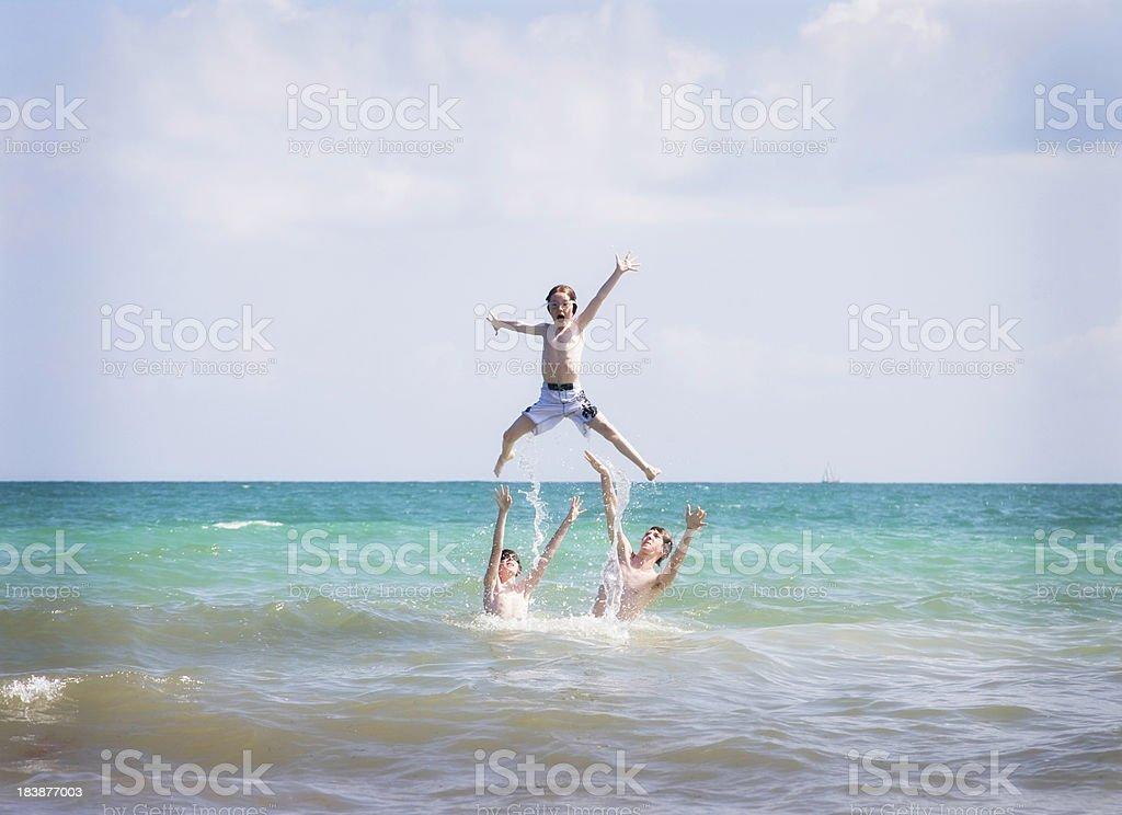 Children Playing in Atlantic Ocean at Bahia Honda State Park stock photo