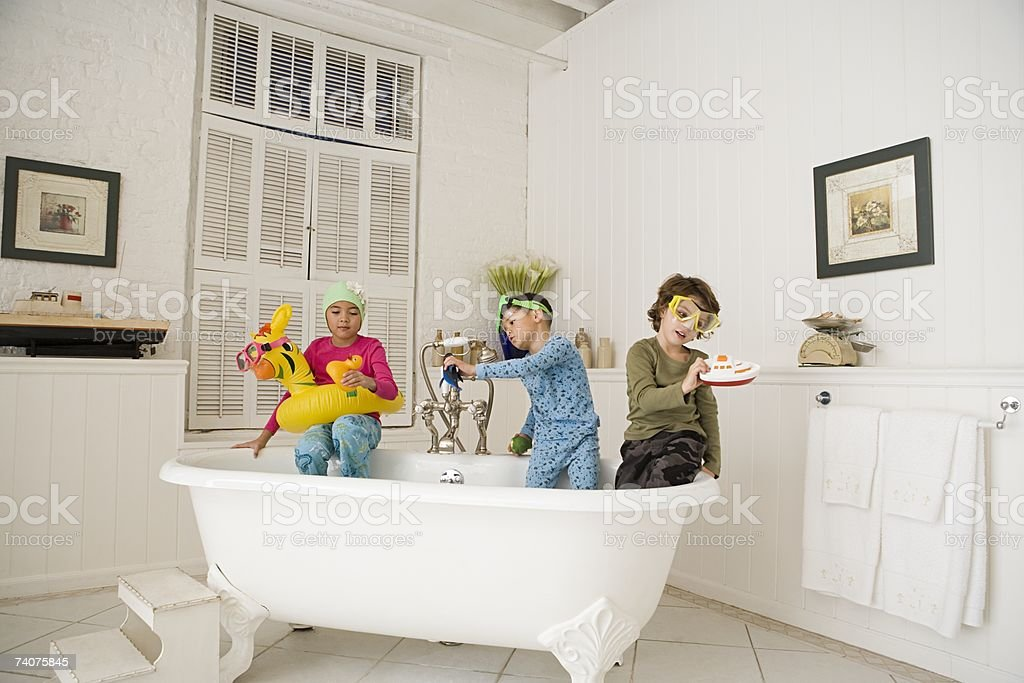 Children playing in bath tub royalty-free stock photo