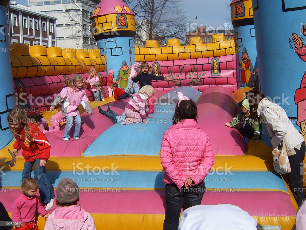 Children playing in bouncy castle stock photo