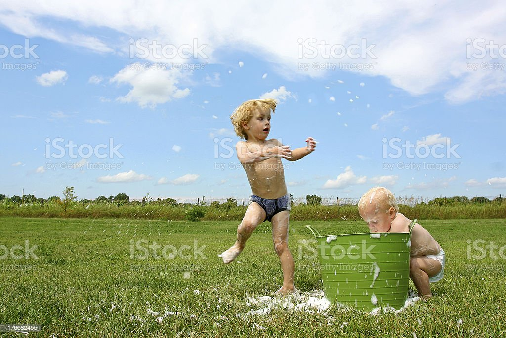 Children Playing in Bubbley Water royalty-free stock photo