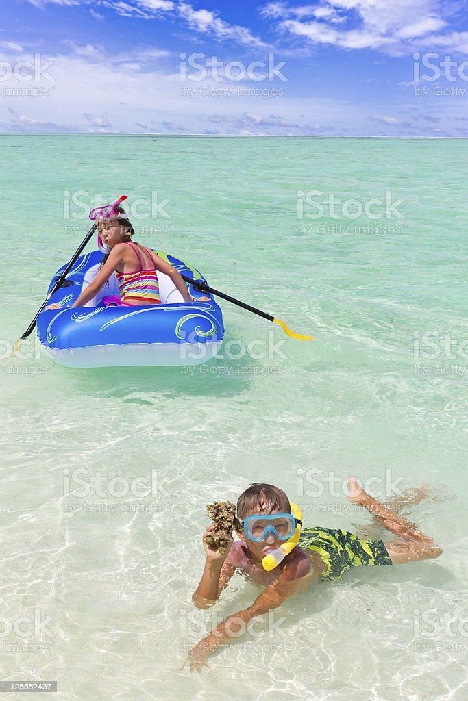 Children playing in ocean royalty-free stock photo