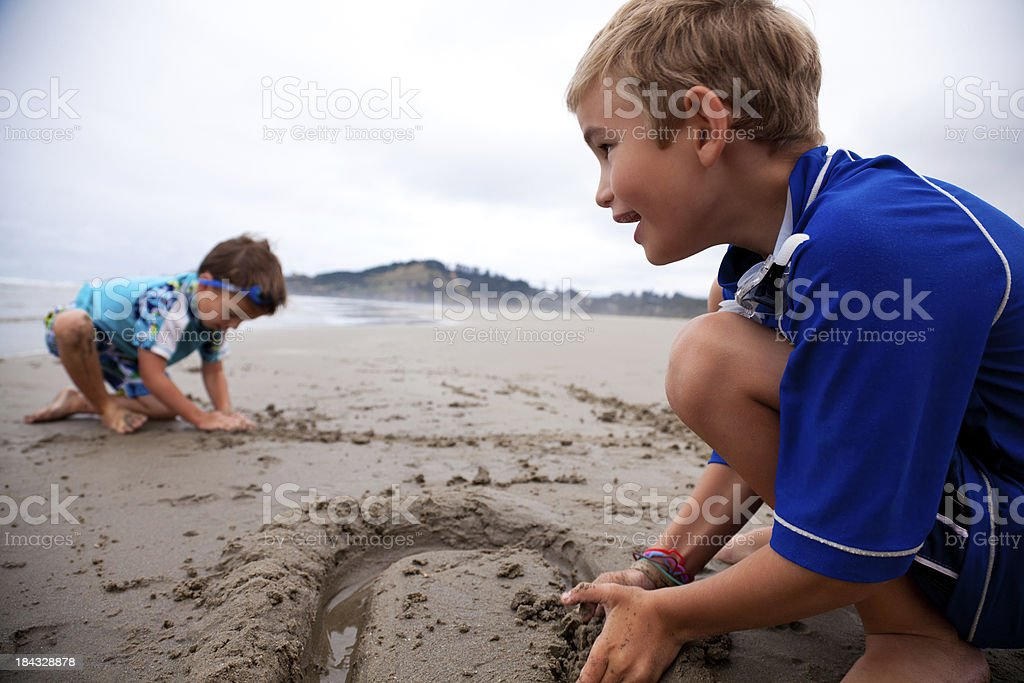 Children Playing in Sand on the Beach stock photo
