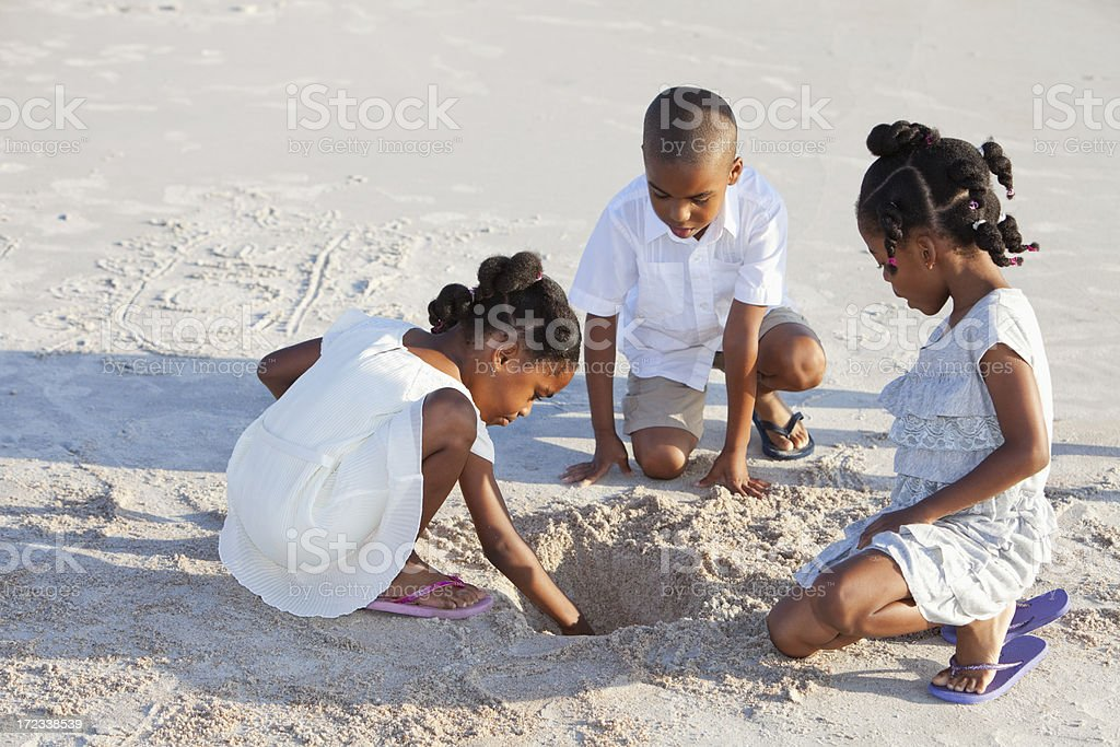 Children playing in sand stock photo