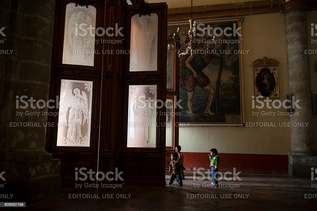 Children playing in the cathedral in Oaxaca, Mexico stock photo