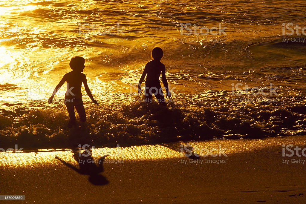 Children Playing In The Ocean royalty-free stock photo
