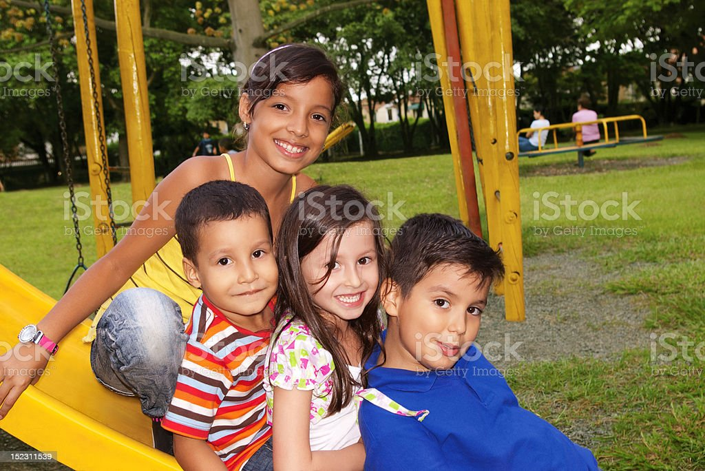 Children playing in the park stock photo
