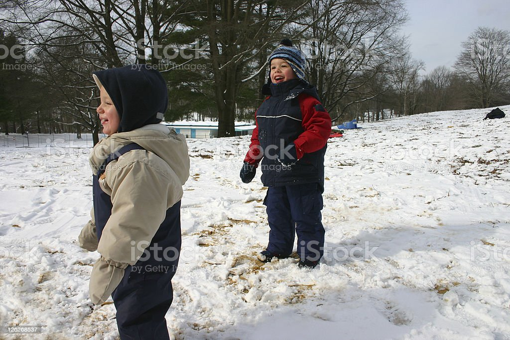 Children playing in the snow and have fun royalty-free stock photo