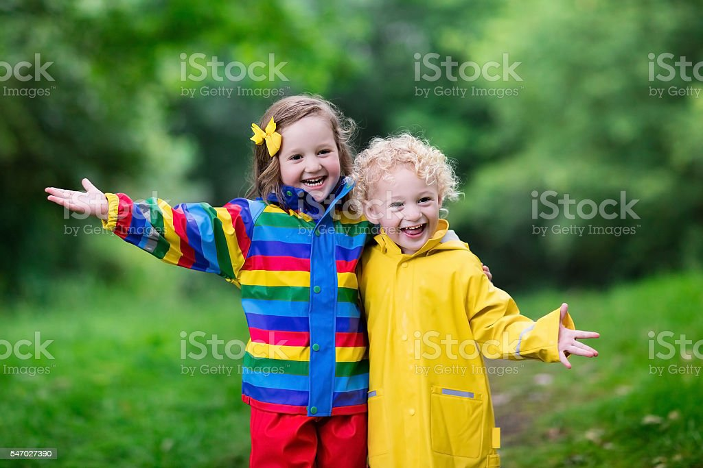 Children playing in the spring rain stock photo