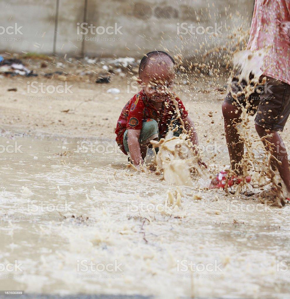 Children Playing Jumping Rainwater Puddle Splashing royalty-free stock photo