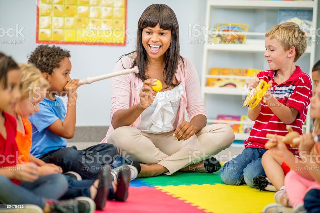 Children Playing Music at Preschool stock photo