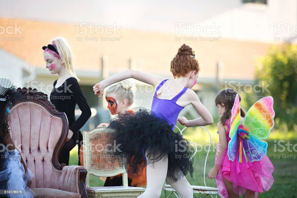 Children Playing Musical Chairs at a Halloween Party stock photo