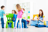 Children Playing Musical Chairs Indoors.