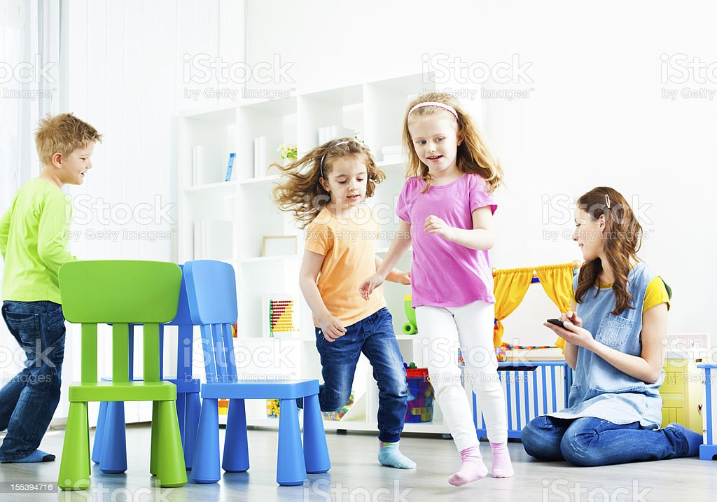 Children Playing Musical Chairs. stock photo