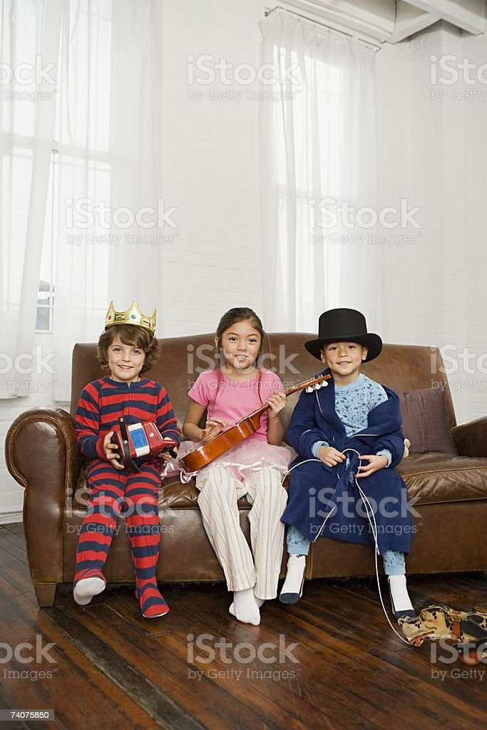 Children playing musical instruments stock photo