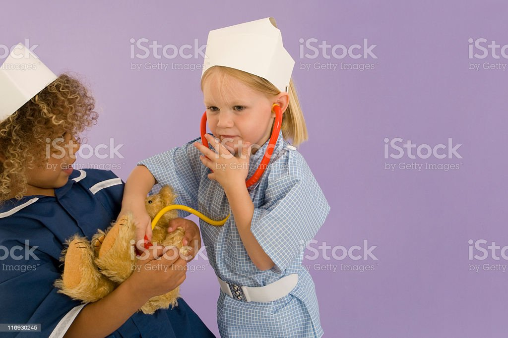 Children playing nurse (XXL) royalty-free stock photo