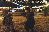 Children playing on Christmas market