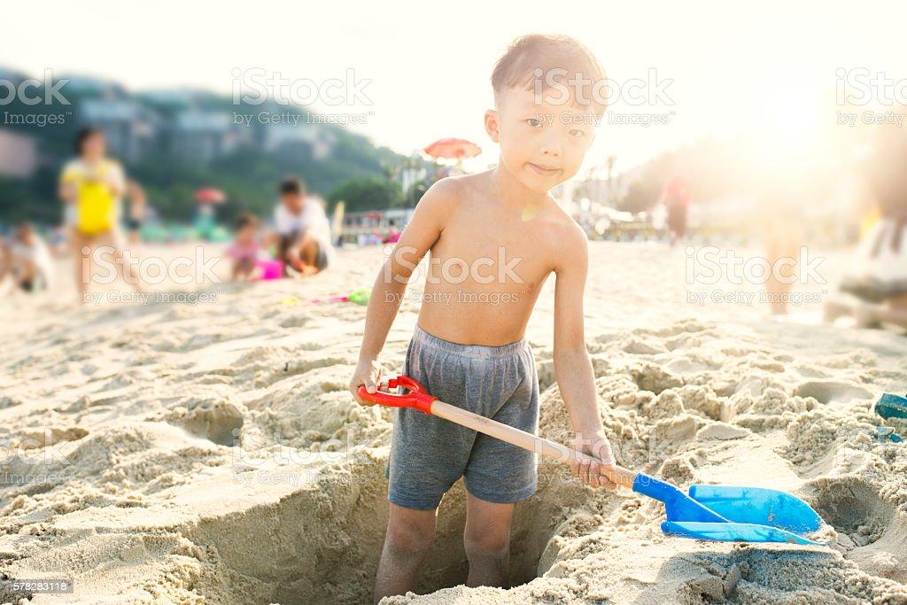 Children playing on the beach stock photo