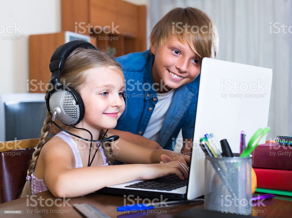 Children playing online game stock photo