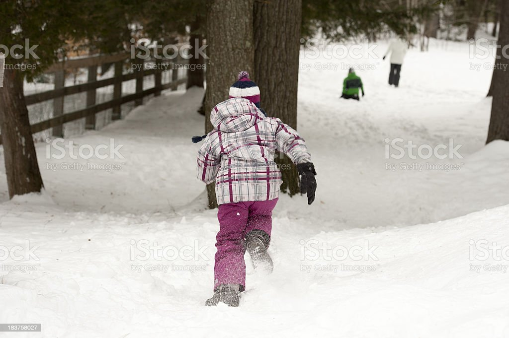children playing outside in winter runing royalty-free stock photo