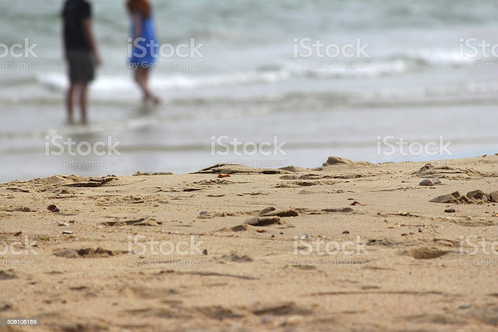 Children playing / paddling in sea at beach, seaside summer holiday stock photo