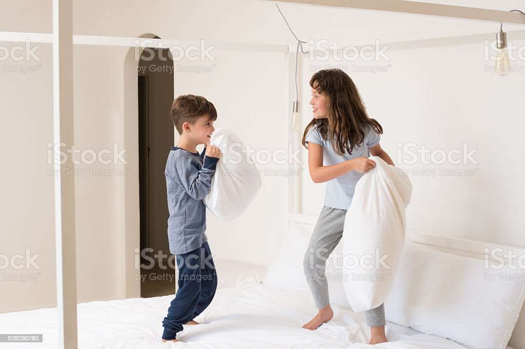 Children playing pillow fight stock photo