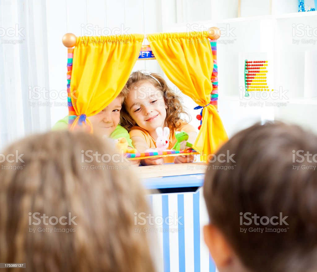 Children Playing Puppet Show. stock photo