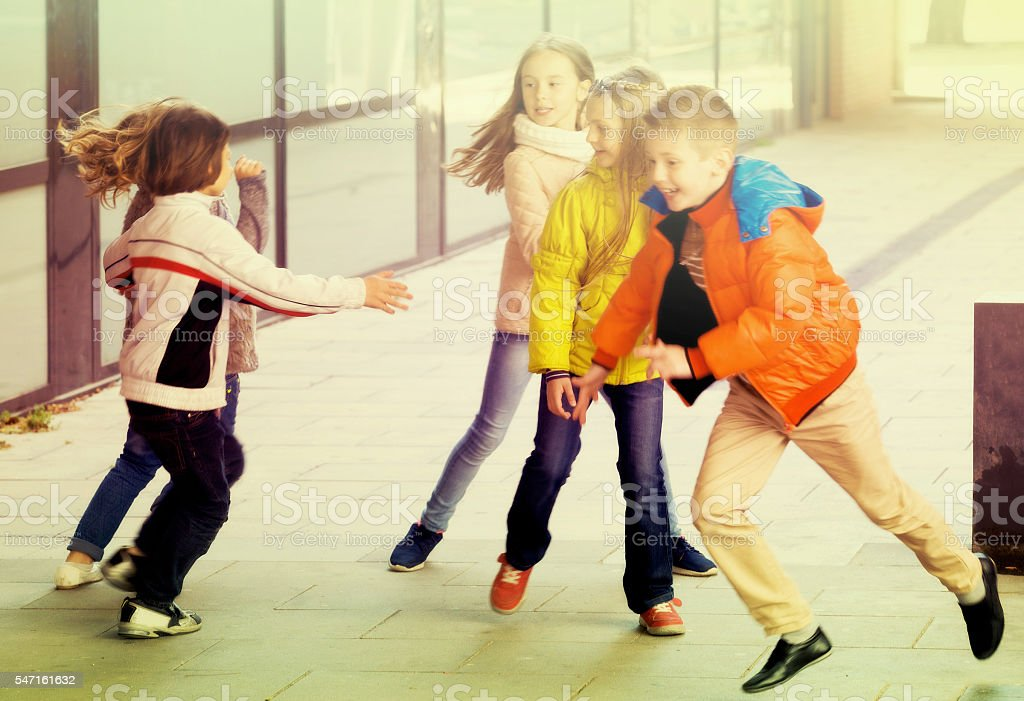 Children playing romp game Touch-last stock photo