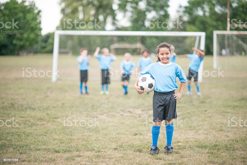 Children Playing Soccer After School stock photo