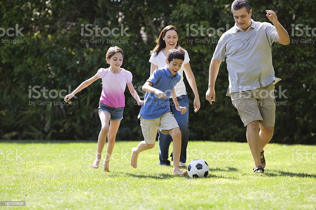 Children Playing Soccer With Parents stock photo
