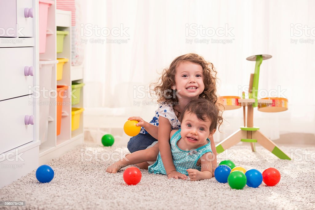 Children playing together at child room. stock photo