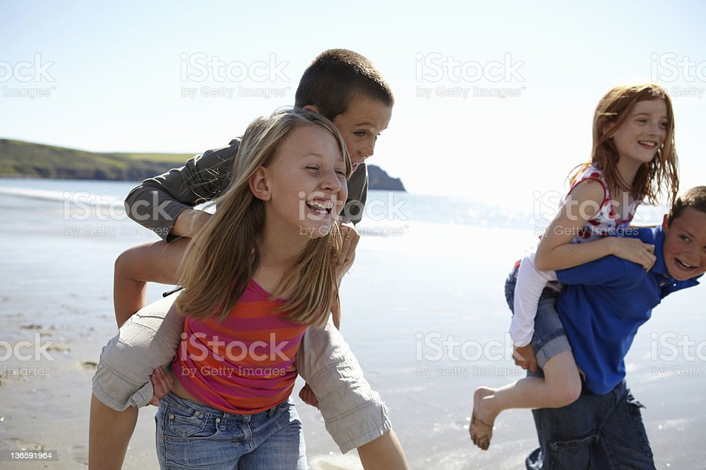 Children playing together on beach royalty-free stock photo
