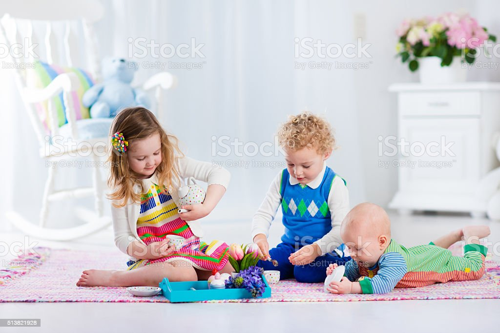 Children playing toy tea party stock photo