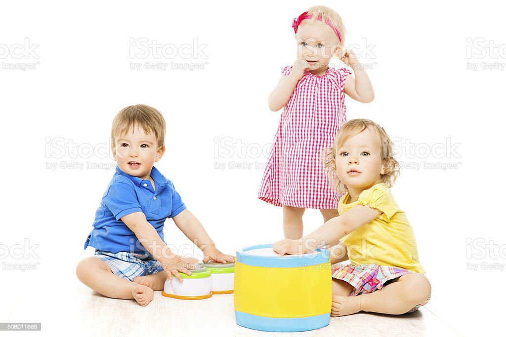 Children playing toys. Small Kids over white background stock photo