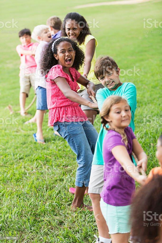 Children playing tug of war royalty-free stock photo