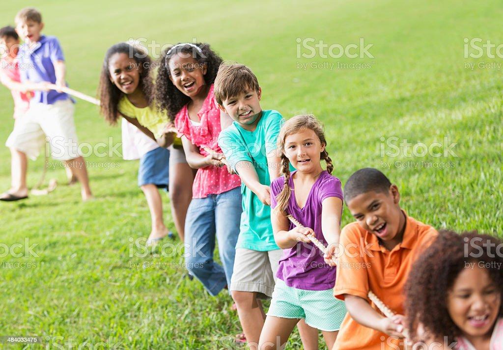 Children playing tug of war stock photo