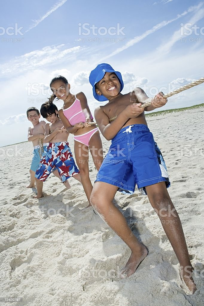 Children playing tug of war stock photo