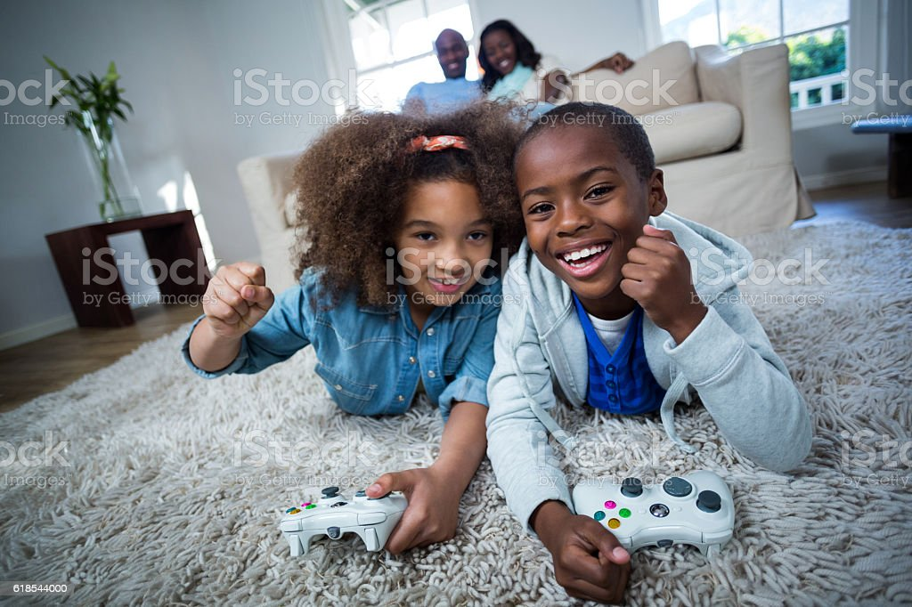 Children playing video games stock photo